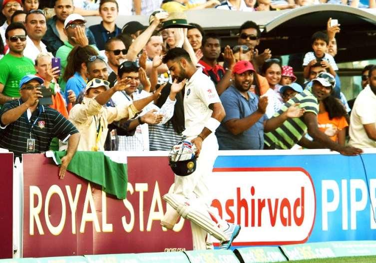 Virat Kolhi walks off after scoring hundred