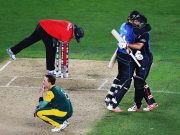 girls look at the game of cricket