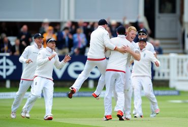 Ben Stokes of England celebrates with his team mates after bowling Brendon McCullum