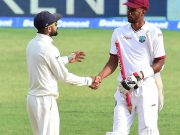 Virat Kohli and Roston Chase West Indies