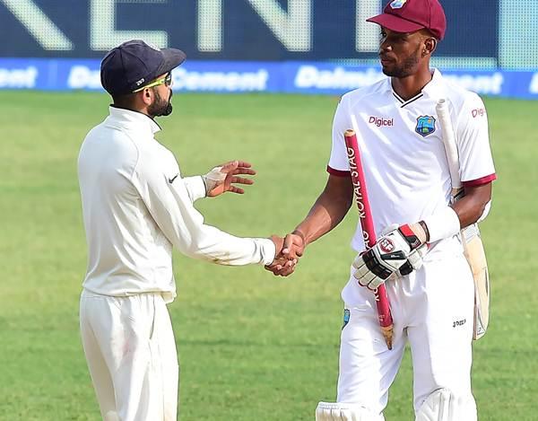 Virat Kohli and Roston Chase West Indies