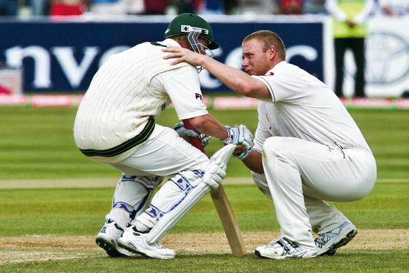 Andrew Flintoff (right) of England consoles Brett Lee