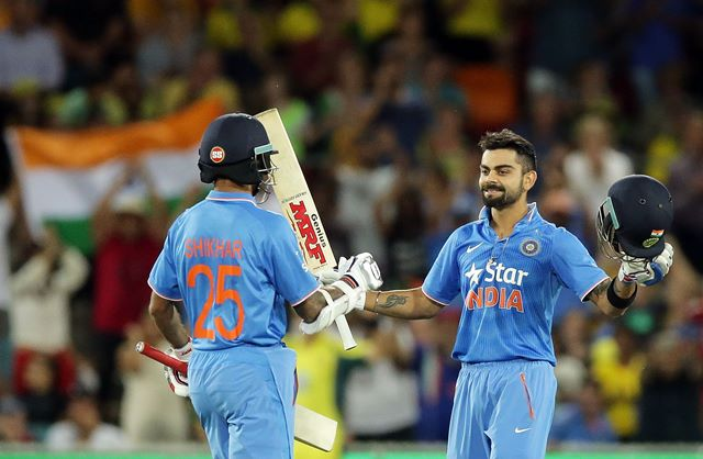 CANBERRA, AUSTRALIA - JANUARY 20: Virat Kohli of India celebrates with team mate Shikhar Dhawan after scoring a century during the Victoria Bitter One Day International match between Australia and India at Manuka Oval on January 20, 2016 in Canberra, Australia. (Photo by Mark Metcalfe - CA/Cricket Australia/Getty Images)