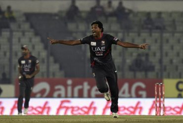 Amjad Javed celebrates after the dismissal
