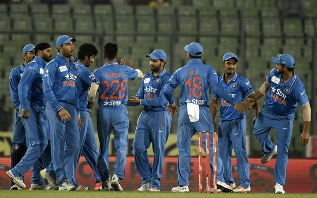 Indian cricketers celebrate after the dismissal of Mohammad Shahzad