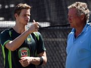Australian cricketer Steve Smith interacts with former captain Kim Hughes during a training session in Adelaide on March 19, 2015, ahead of the 2015 Cricket World Cup quarter-final match between Australia and Pakistan. AFP PHOTO / INDRANIL MUKHERJEE -- IMAGE RESTRICTED TO EDITORIAL USE - STRICTLY NO COMMERCIAL USE-- (Photo credit should read INDRANIL MUKHERJEE/AFP/Getty Images)