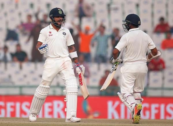 Virat Kohli and Parthiv Patel India