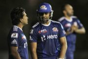 Sachin Tendulkar talking with teammate Rohit Sharma