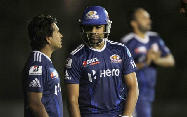 Sachin Tendulkar talking with teammate Rohit Sharma
