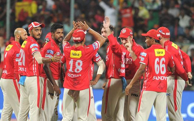 Kings XI Punjab players celebrate fall of a wicket