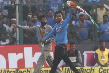 A Virat Kohli's fan entered the ground to congratulate him