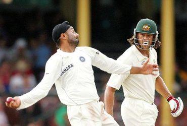 Andrew Symonds of Australia watches Harbhajan Singh