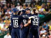 Jos Buttler of England celebrates with team mates after taking the catch to dismiss Steve Smith