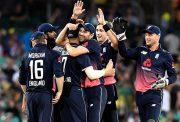 Chris Woakes of England celebrates with teammates
