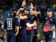 Chris Woakes of England celebrates with teammates