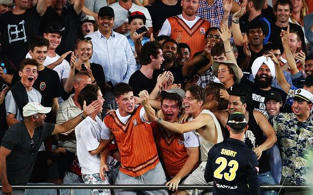 A fan catches a six one-handed to win $50,000 as part of the Tui catch competition during the International Twenty20 match between New Zealand and Australia at Eden Park.