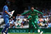 Mohammad Amir of Pakistan celebrates after claiming the wicket of India's Virat Kohli left-handed XI