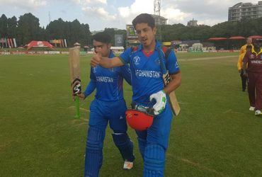 Sharafuddin Ashraf and Rashid Khan leave the field after the victory
