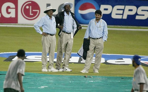 Umpires Venkat and Steve Bucknor carry out a pitch inspection after rain during the ICC Cricket World Cup 2003 Pool B match between South Africa and Sri Lanka