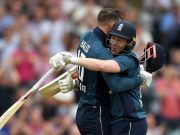 Alex Hales of England celebrates reaching his century with captain Eoin Morgan