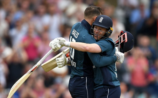Alex Hales of England celebrates reaching his century with captain Eoin Morgan