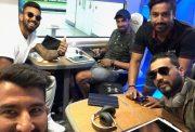 Cheteshwar Pujara with his teammates
