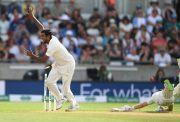 India bowler Ravi Ashwin celebrates as England batsman Joe Root is run out by a direct throw from Virat Kohli