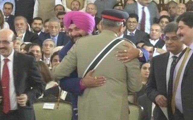 Former Indian cricketer Navjot Singh Sidhu hugts Pakistan Army Chief General Qamar Javed Bajwa at Imran Khan's oath-taking ceremony in Islamabad