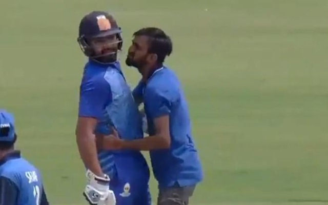 A fan kisses Rohit Sharma
