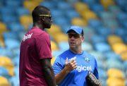 Windies coach Stuart Law speaks with captain Jason Holder