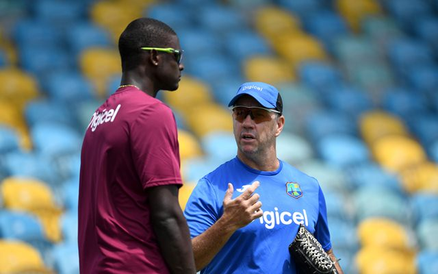 Windies coach Stuart Law speaks with captain Jason Holder