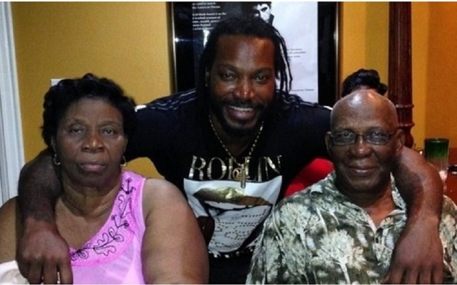 Chris Gayle with his mother and father