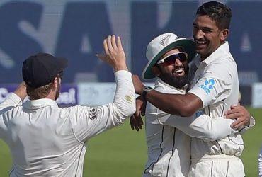 New Zealand spinner Ish Sodhi celebrates with teammate Ajaz Patel