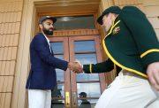 Virat Kohli and Tim Paine shake hands