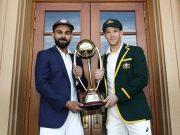 Virat Kohli and Tim Paine pose with the Border–Gavaskar Trophy
