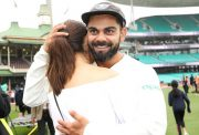 Virat Kohli of India embraces his wife Anushka Sharma