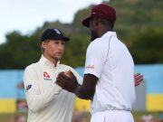 Joe Root talks with Jason Holder
