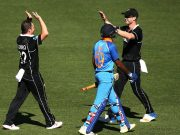 Jimmy Neesham and Colin Munro celebrate after taking the wicket of Vijay Shankar