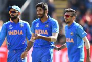 India's Jasprit Bumrah (C) celebrates with India's captain Virat Kohli (L) and teammates after taking the wicket of Bangladesh's Soumya Sarkar for 25 during the 2019 Cricket World Cup warm up match between Bangladesh v India at Sophia Gardens stadium in Cardiff, south Wales, on May 28, 2019. (Photo by Glyn KIRK / AFP) (Photo credit should read GLYN KIRK/AFP/Getty Images)