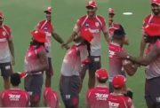 Chris Gayle and Sheldon Cottrell