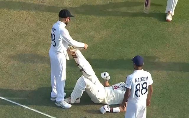 Virat Kohli helping Joe Root