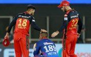 Virat Kohli and Glenn Maxwell consoling Shimron Hetmyer