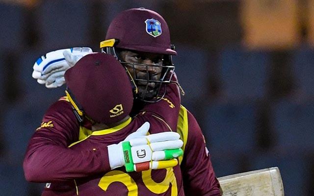 Nicholas Pooran congratulateS Chris Gayle of West Indies for reaching his half century