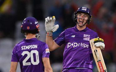 Harry Brook celebrates victory with John Simpson