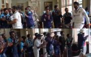 Indian players congratulating Mohammed Shami and Jasprit Bumrah